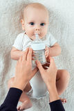 Baby eats from nipples Royalty Free Stock Photos