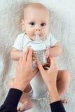 Baby eats from nipples royalty free stock photos