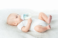 Baby eats from nipples stock image
