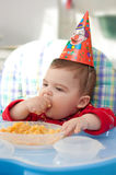 Baby eats porridge Stock Photography