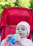 The baby eats a puree from a supermarket Stock Image