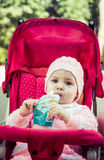 The baby eats a puree from a supermarket Royalty Free Stock Photos