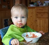 Baby eats quinoa with vegetables Stock Images
