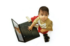 Baby editing images with laptop Stock Photo
