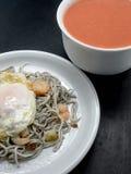 Baby eels or elver substitute in garlic sauce Royalty Free Stock Image