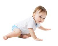 Baby in een en overhemd die kruipen lachen stock foto