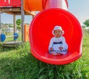 Baby in een Speelplaats Stock Foto
