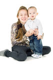 Baby with the elder sister hug Stock Image