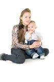 Baby with the elder sister hug Stock Photo