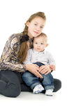 Baby with the elder sister hug Royalty Free Stock Images