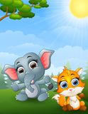Baby elephant and baby fox cartoon in the jungle. Illustration of Baby elephant and baby fox cartoon in the jungle Royalty Free Stock Photos