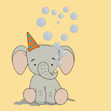 Baby elephant with bubbles heart. On yellow background Royalty Free Stock Image