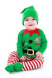 Baby elf. Baby wearing elf outfit - babies first Christmas stock images