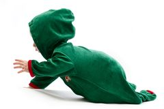 Baby in elf-costume Stock Images