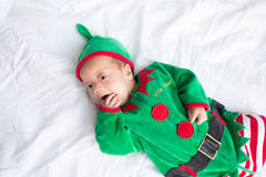 Baby in elf costume for christmas holiday on white Royalty Free Stock Photos