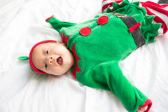 Baby in elf costume for christmas holiday on white Royalty Free Stock Photography