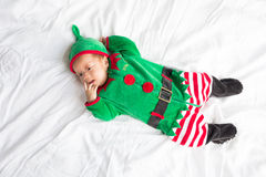 Baby in elf costume for christmas holiday on white Stock Image