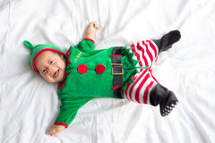 Baby in elf costume for christmas holiday on white Stock Photography