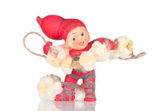 Baby elf toy. Baby elf carrying popcorn over a white reflective background Royalty Free Stock Image