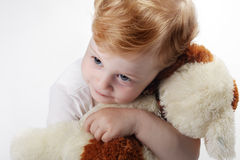 Baby embrace toy dog Stock Photography