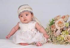Baby en bloem Stock Foto's