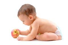 Baby en een Appel Stock Foto