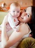 Baby en moeder stock foto