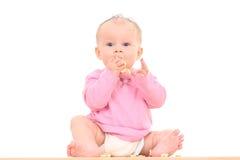 Baby en snack stock foto's