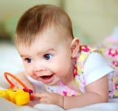 Baby en stuk speelgoed Stock Afbeelding