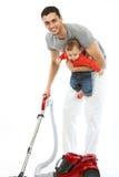 Baby en Vader - Huishoudelijk werk Stock Fotografie