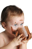 Baby enjoying the moment, eating chocolate Royalty Free Stock Photo