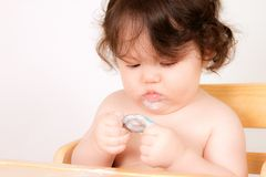 Baby Enjoys a Snack Stock Photography