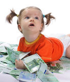 Baby and euro. A child plays with a money Royalty Free Stock Photos