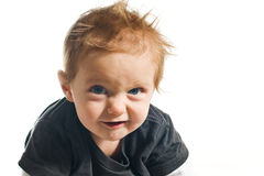 Baby with evil facial expression Royalty Free Stock Photos