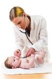 Baby examination with stethoscope Stock Photo