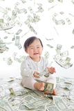 Baby excited smile with money rain. In the air isolated on a white background, concept for business, asian girl baby child Royalty Free Stock Images