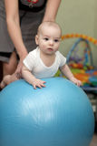 Baby exercises on ball Royalty Free Stock Photo