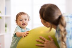 Baby exercises on fitball. Gymnastics for children Royalty Free Stock Photo