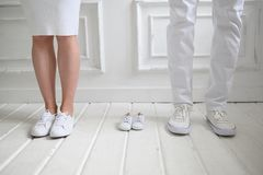Baby expecting picture with mother, father. Mother, father and their future baby royalty free stock image