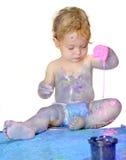 Baby explores finger paints Stock Photos