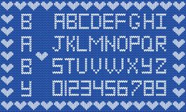 Baby fabric script for boy. Cute knitted abc alphabet. Knitting pattern, boy navy blue fabric background framed with little hearts. Useful for cards Stock Image