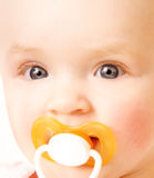 Baby face. Baby with dummy / shallow DOF Stock Image