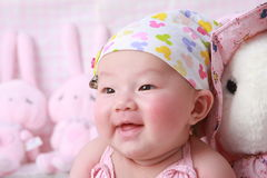 Baby face. Happy,cute baby in her 100 days Royalty Free Stock Photos