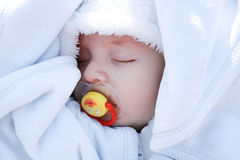 Baby face. Baby sleeps with a pacifier in her mouth Stock Image