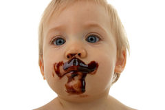 Baby face with chocolate Stock Photos