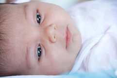 Baby face close-up, with selective focus. Royalty Free Stock Images