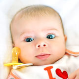 Baby face and pacifier Royalty Free Stock Photo