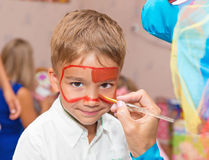 Baby face paint Royalty Free Stock Photo