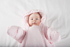 Baby face wrapped in pink snowsuit Royalty Free Stock Photo
