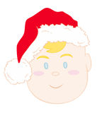 Baby face with xmas red hat. Royalty Free Stock Image